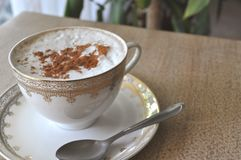 Cappuccino coffee in an antique porcelain cup Royalty Free Stock Images