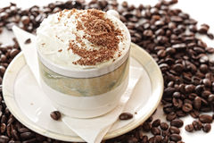 Cappuccino coffee on beans Stock Image
