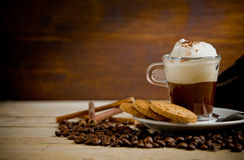 Cappuccino on coffee beans Royalty Free Stock Photo