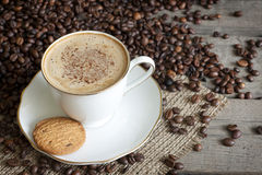 Cappuccino and coffee beans Stock Photos