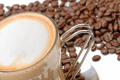 Cappuccino and coffee beans Royalty Free Stock Photography