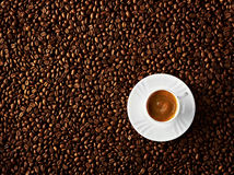 Cappuccino on coffee beans background. A cup of cappuccino on coffee beans background Royalty Free Stock Image