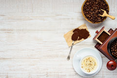 Cappuccino Coffee with Beans and Grinder on Copy Space stock photos