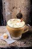 Cappuccino coffee with cream topped with sprinkled chocolate on Royalty Free Stock Photos