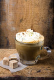 Cappuccino coffee with cream topped with sprinkled chocolate on Stock Photography