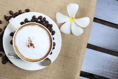 Cappuccino coffee cup and beans Stock Image