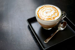Cappuccino coffee. Cup of cappuccino coffee on dark table background Royalty Free Stock Photography