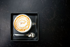 Cappuccino coffee. Cup of cappuccino coffee on dark table background Stock Photography