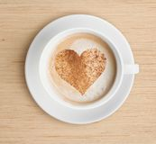 Cappuccino coffee cup with foam and heart shape Royalty Free Stock Image