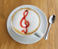 Cappuccino coffee cup with musical sign Stock Photos