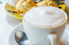 Cappuccino. Coffee cup with scone Stock Photography