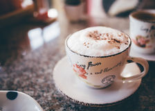 Cappuccino coffee cup on a table Royalty Free Stock Photos