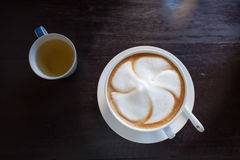 Cappuccino coffee cup with tea cup Stock Photo