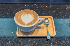 Cappuccino coffee cup on wood table,vintage. Cappuccino coffee cup on wood table vintage Royalty Free Stock Image