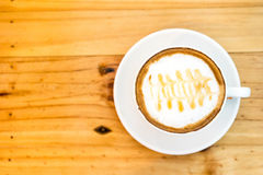 Cappuccino coffee cup on wooden table ,soft focus Stock Photos