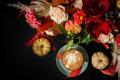 Cappuccino coffee and flowers composition on black background Royalty Free Stock Photo