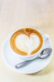 Cappuccino coffee with heart drawing in white cup. Cappuccino coffee with heart drawing as love meaning in white cup Stock Photo