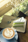Cappuccino coffee with latte art and cake slice desserts. On table royalty free stock photos