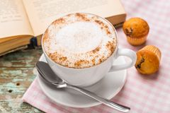 Cappuccino coffee with muffins Stock Images