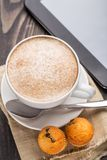 Cappuccino coffee with muffins Royalty Free Stock Photo