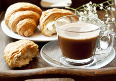 Cappuccino Coffee in Transparent Cup and Croissants Stock Image