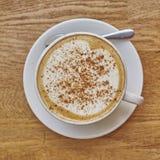 Cappuccino coffee in white cup closeup Stock Image
