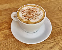 Cappuccino coffee in white cup closeup Royalty Free Stock Images