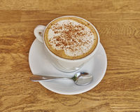 Cappuccino coffee in white cup closeup Royalty Free Stock Photo