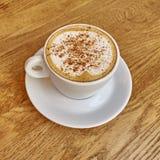 Cappuccino coffee in white cup closeup Stock Photos