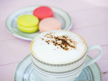 Cappuccino coffee in white cup on wooden Royalty Free Stock Images