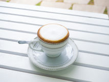 Cappuccino coffee in white cup Stock Photos