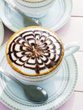Cappuccino coffee in white cup on wooden table Stock Photography