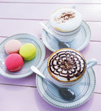 Cappuccino coffee in white cup on wooden table Stock Photos
