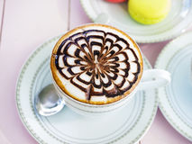 Cappuccino coffee in white cup on wooden table Stock Images