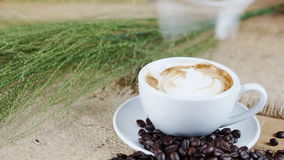 Cappuccino Coffee on wood table Royalty Free Stock Photo