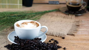 Cappuccino Coffee on wood table Stock Images