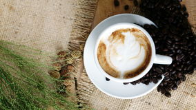 Cappuccino Coffee on wood table Royalty Free Stock Images