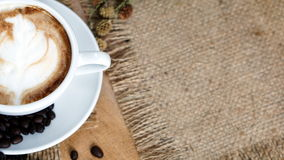 Cappuccino Coffee on wood table Royalty Free Stock Photography