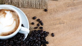 Cappuccino Coffee on wood table Royalty Free Stock Image
