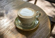 Cappuccino coffee on wooden table. In cafe Royalty Free Stock Photo