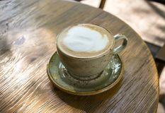 Cappuccino coffee on wooden table. In cafe Stock Photo