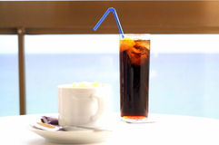 Cappuccino and coke Royalty Free Stock Photo