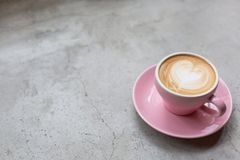 Cappuccino on a concrete surface stock photo