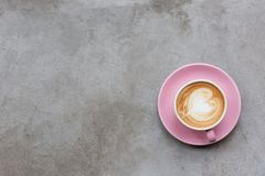 Cappuccino on a concrete surface royalty free stock images