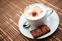 Cappuccino with a Cookie Stock Photos