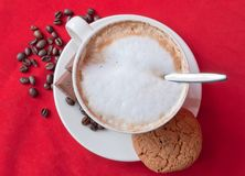 Cappuccino, cookie and beans Royalty Free Stock Images