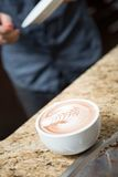 Cappuccino At Counter In Coffeeshop Stock Photo