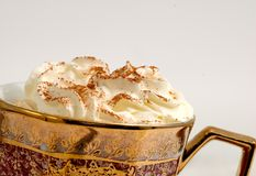 Cappuccino with cream. Cappuccino cup with magnificent cream foam and cinnamon dressing Stock Photo