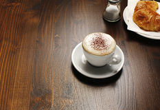 Cappuccino and croissant Royalty Free Stock Photos