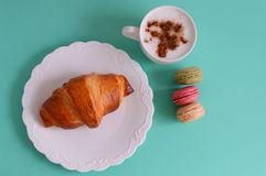 Cappuccino with croissant and macarons Stock Photography